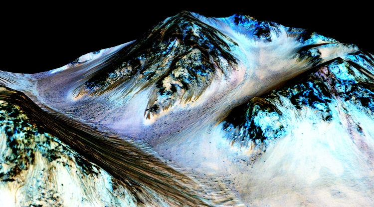 The narrow, dark streaks, or recurring slope lineae, flowing downhill on Mars are inferred to have been formed by contemporary flowing water.