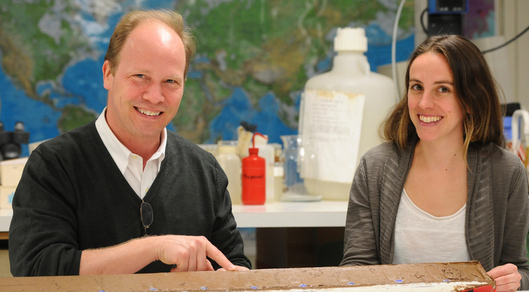 Researchers Peter deMenocal and Jessica Tierney examine a core of marine sediments taken off the coast of West Africa. The two used that and other marine cores to figure out the Sahara's climate 25,000 years into the past. (Photo: Lamont-Doherty Earth Observatory)