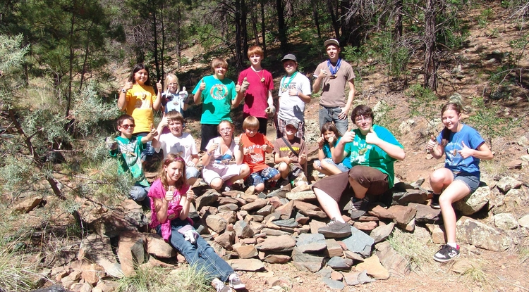 Youth give back to the camp and its natural surroundings through service learning projects, like building gabion dams to prevent soil erosion in the watershed.