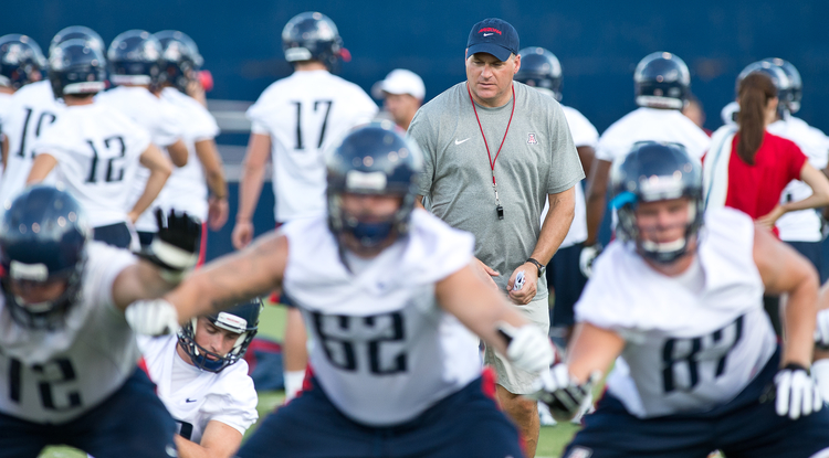 UA football coach Rich Rodriguez officially opened his first season this week.