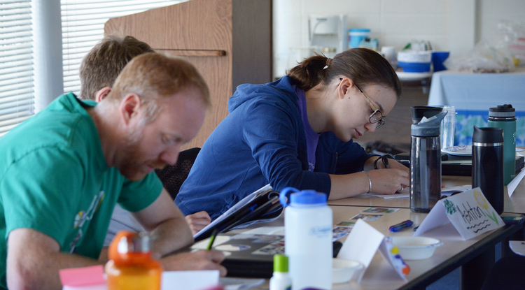 Middle school teacher Ryan Robinson and high school teacher Valerie Thaler deep in writing mode (Photo: Anna Augustowska)