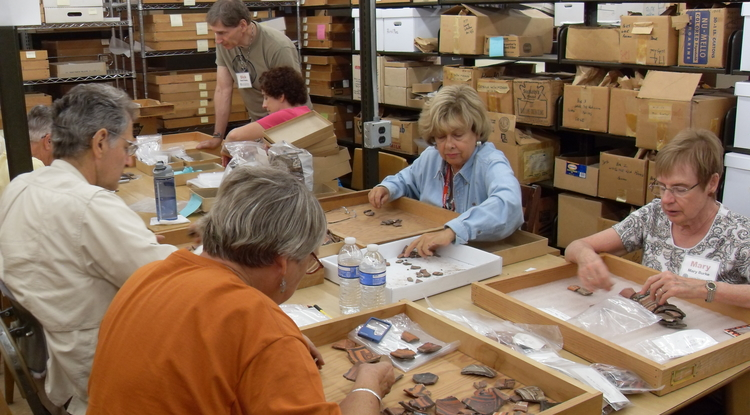 Campers sort pottery sherds excavated from Point of Pines Pueblo during the 1950s.