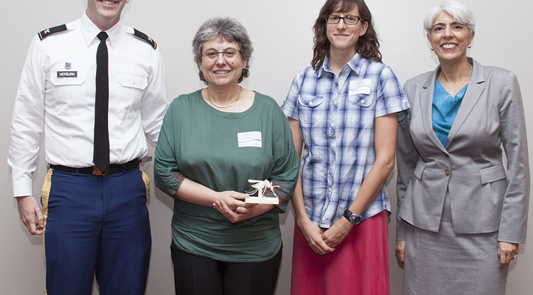 Col. Matt Hepburn (left), the DARPA program manager for the CHIKV Challenge, with UA researchers Joceline Lega and Heidi Brown and also Arati Prabhakar, director of the Defense Advanced Research Projects Agency.