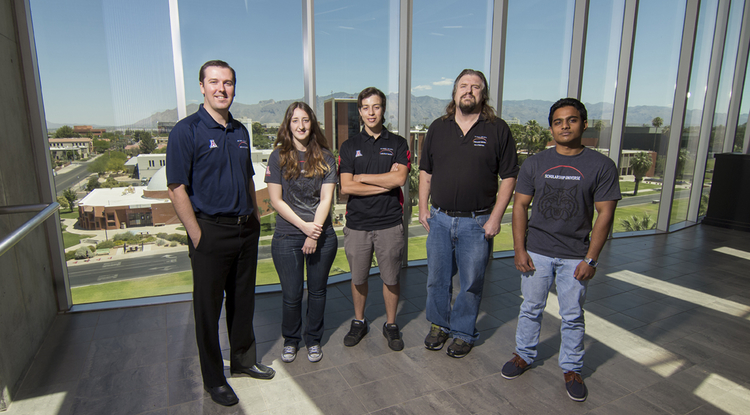 The Scholarship Universe team (from left): Ken Downs, program manager; Emily Romero; Rafael Garcia; don-E Merson, applications systems analyst/developer, principal/architect; and Sachin N. Nalavattanon. (Photo courtesy of UA Student Affairs)