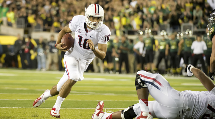 UA quarterback Matt Sott runs the ball during last week's game against Oregon. (Photos courtesy of Arizona Athletics)