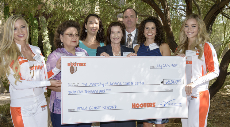 The V Foundation for Cancer Research presented a check for $65,000 to Arizona Cancer Center researchers Chris Segrin and Terry Badger to fund their research aimed at recruiting rural Latinas with breast cancer and their family partners into clinical trials. (Photo: Kristen Hanning, AHS BioCommunications)