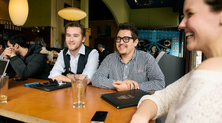 "SociaLink co-founders, Michael Jacobs (left) and Hector Rosales (right) began developing their mobile app while studying abroad in India. Rosales said the time difference worked in their favor when trying to communicate with their partners abroad as the two wrapped up their day with e-mails to the team in India, whose day is just beginning. ""When it came to having face-to-face interactions on Skype, Michael and I would have to stay up until one in the morning,"" he said. (Photo courtesy of Hector Rosales)"