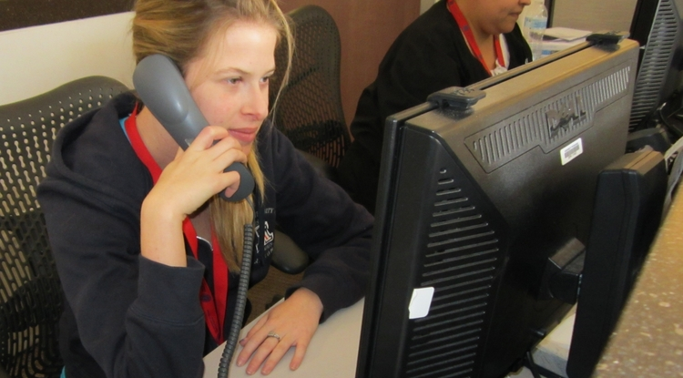 Participant Sydney Kramer takes a call during her Project SEARCH internship in the emergecy department at The University of Arizona Medical Center-South Campus. Project SEARCH prepares young people with disabilities to be competitive in the workforce.