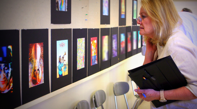 The competition this year was intense. Jo Alenson, the marketing director for UApresents, was one of the judges on site who studied each of the submissions while trying to determine which would best represent the 2013-14 UApresent season.