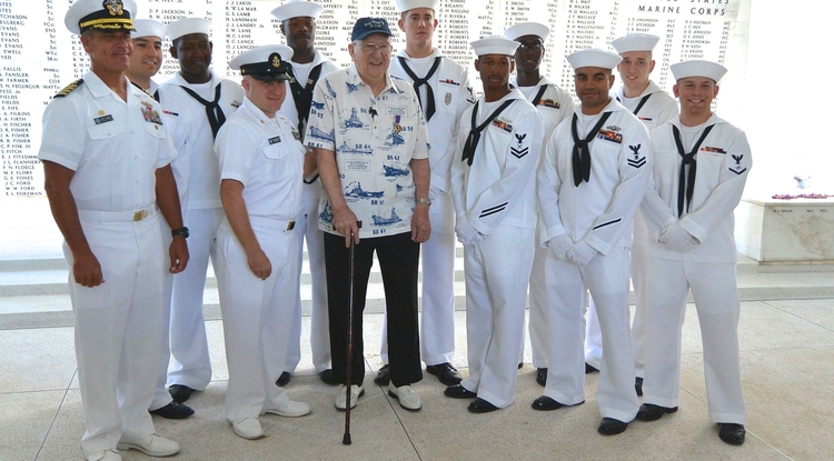 In June 2013, Lauren Bruner visited the USS Arizona Memorial in Pearl Harbor. Bruner is surrounded by the Honor Guard and, on the far left, Navy Capt. Jeff James. Bruner received a Purple Heart after being wounded in battle on the USS Arizona. (Photo credit: Mark Comon)