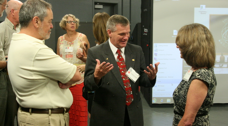 UA College of Education Dean Ron Marx (left) and Renée Clift (right), an associate dean, receive an introduction from Iowa educator and principal Rex Kozak to the Virtual Reality Education Pathfinders program Raytheon Missile Systems is introducing in the Tucson region.