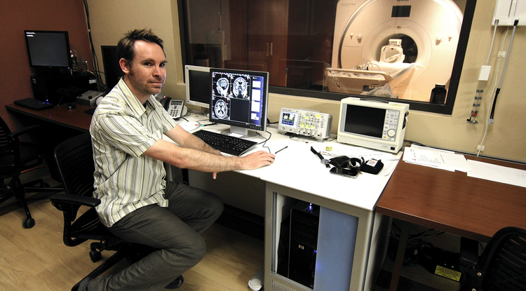 Stephen Wilson takes images of study participants' brains using a state-of-the-art MRI scanner acquired by the UA only last year. Housed in the newly improved medical imaging facility, this scanner is exclusively dedicated to research. (Photo: Daniel Stolte/UANews)