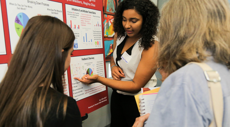 Natalynn Masters explains her team's findings to community members. (Photo: Anna Augustowska/College of Social and Behavioral Sciences)