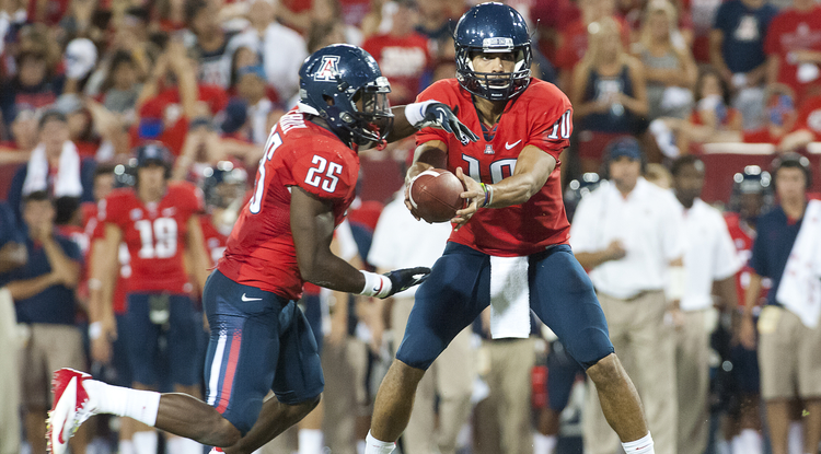Matt Scott hands off the ball to Ka'Deem Carey. (Photos courtesy of Arizona Athletics)