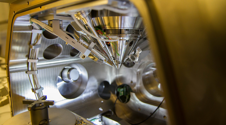 A focused-ion-beam scanning-electron microscope, capable of drilling a hole in a piece of dust, will help provide a nanoscopic look at the asteroid sample from OSIRIS-REx. (Photo: Mari Cleven/UA Office of Research, Discovery and Innovation)