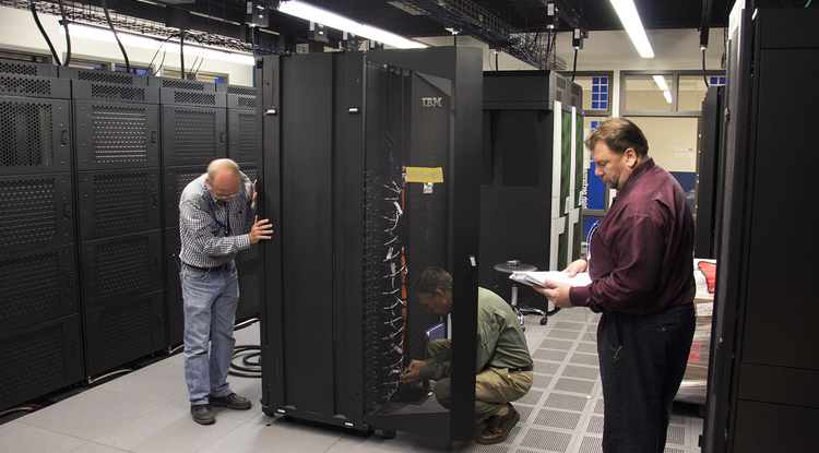 The supercomputer consists of many subunits housed in three refrigerator-sized cabinets. (Photo: Cyrus Ahmadi/Office of the CIO)