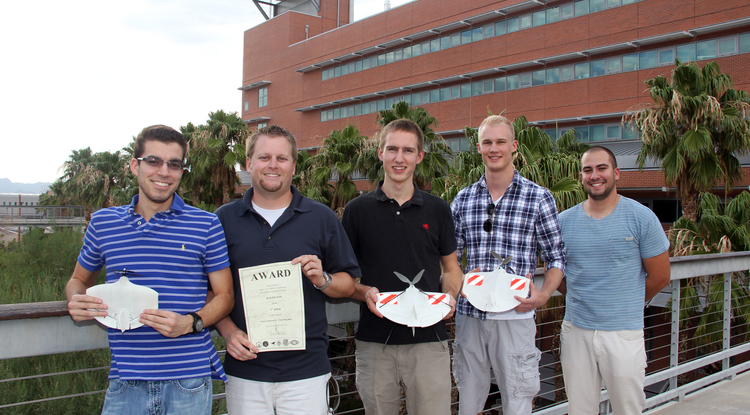 UA MAV team members who won first place in the IMAV 2012 indoor autonomous flight competition are, from left, Brandon Pitts, Jeff Olmstead, Jordan Odle, Aaron Petras, and Sean Katsarelis. Not pictured is UA AME graduate Daigaro Cota.