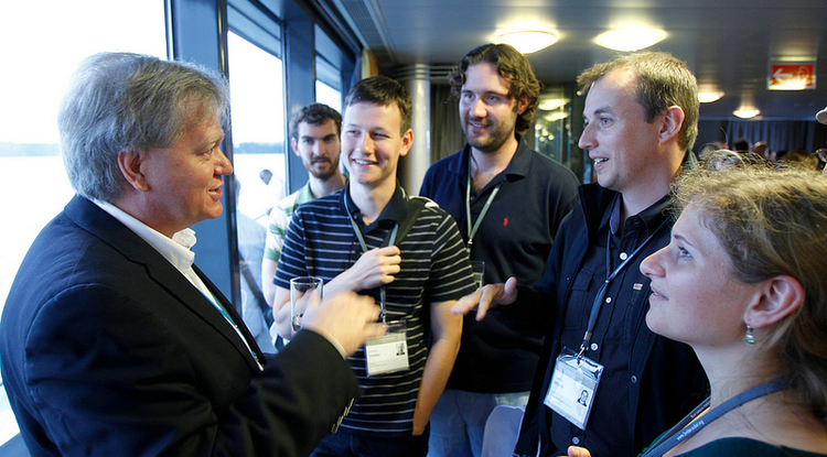 Nobel Laureate Brian Schmidt visits with emerging researchers during the July 1-6 Lindau Nobel Laureate meeting held in Germany.