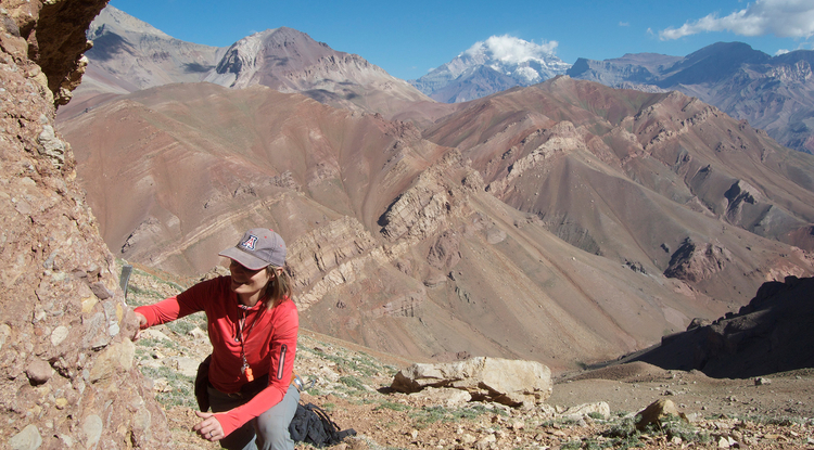 Barbara Carrapa takes rock samples at 14,000 feet (4267 m) on Cerro Penitentes in the Cordillera Central of Argentina. (Photo: Peter DeCelles/University of Arizona)