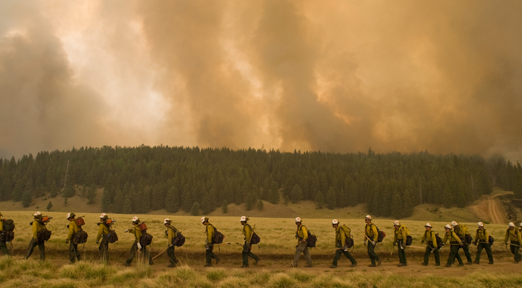 Firefighters on their way to fight the Las Conchas Fire, which burned more than 150,000 acres in New Mexico in 2011. The blaze became the largest wildfire in the state's history at the time. Wildfires are among the list of risks the new center will help manage. (Photo: Kari Greer)