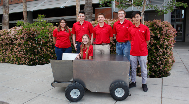 Savannah Brown, Sean Rowlands, Cooper Wynn, Devin Murphy and Weicheng Li, with Hannah Whetzel acting as a stand-in for a grasshopper in the grasshopper catcher they designed for Engineering Design Day. (Photo: Emily Dieckman/UA College of Engineering)