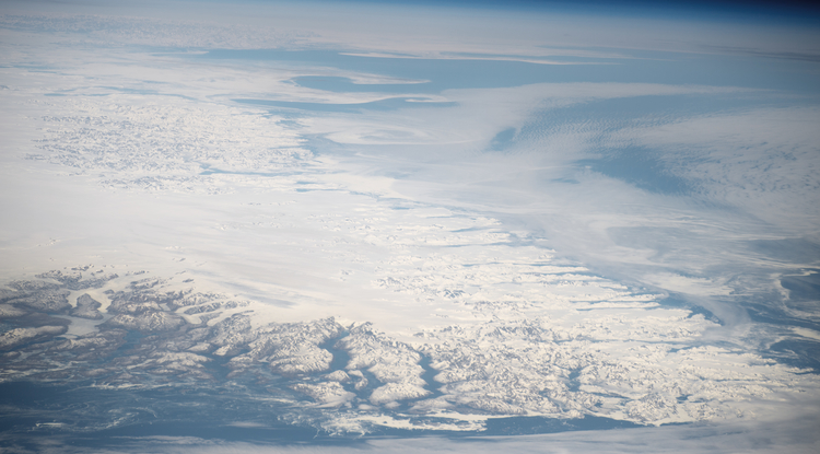 Taken from the International Space Station in 2016, this picture of the southern tip of Greenland shows the island's vast ice sheet fringed by glacier-carved fjords. If all Greenland's ice melted, sea levels would rise by about 7 meters (23 feet). (Photo: NASA)