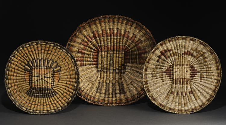 Wicker plaques from Third Mesa, made from rabbitbrush, dune broom and yucca, from left: Hiilili katsina, ca. 1935; Si'ohemiskatsina (Zuni Hemis katsina), ca. 1910; Sa'lakwmana (Shalako maiden katsina), ca. 1905. (Photo courtesy of Arizona State Museum)
