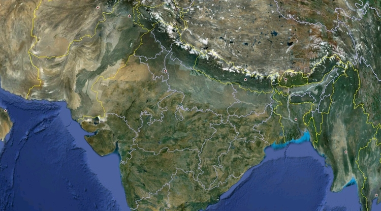 Pushing north against the Eurasian Plate, the Indian Plate dives into the Earth's interior, pushing up the Himalayas in the process. At the contact zone, visible as an arch in this Google Earth image, immense stress builds up, causing earthquakes including devastating ones like the one in Nepal.