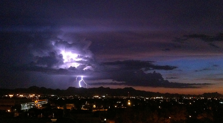 In the American Southwest, precipitation during the summer monsoon season provides a significant portion of the annual precipitation. Here lightning strikes over Southern Arizona's Tucson mountains during a 2010 monsoon thunderstorm. (Image (c) Daniel Griffin/University of Arizona)