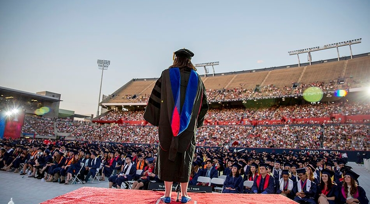 Professor Melissa Fitch addresses the crowd during the pre-Commencement show last year. Thousands of UA students will receive degrees during the 2017 ceremony, to be held in Arizona Stadium on May 12. (Photo: John de Dios/UANews)
