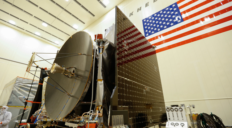 The high gain antenna and solar arrays are installed on the OSIRIS-REx spacecraft before moving to environmental testing. (Photo: Lockheed Martin)