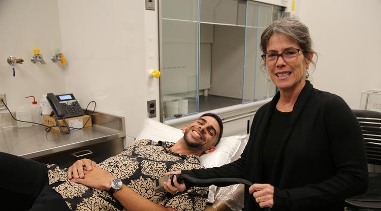 Alexander Alvarez and Sonia Vohnout demonstrate the acoustoelectric cardiac imaging invention. (Photo: Eddie San Juan/Tech Launch Arizona)