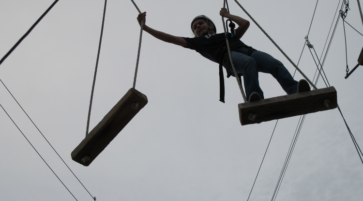 Sydney Cope does the high ropes course as part of Arizona Operation: Military Kids, a program designed to build resilience in kids whose parents are in the military reserves.