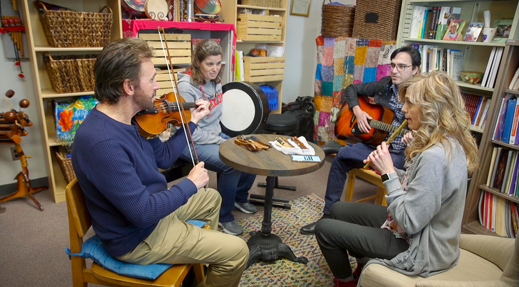 Members of Tíolacadh, the UA's traditional Irish music ensemble, learn tunes from each other by ear. (Photo: Bob Demers/UANews)