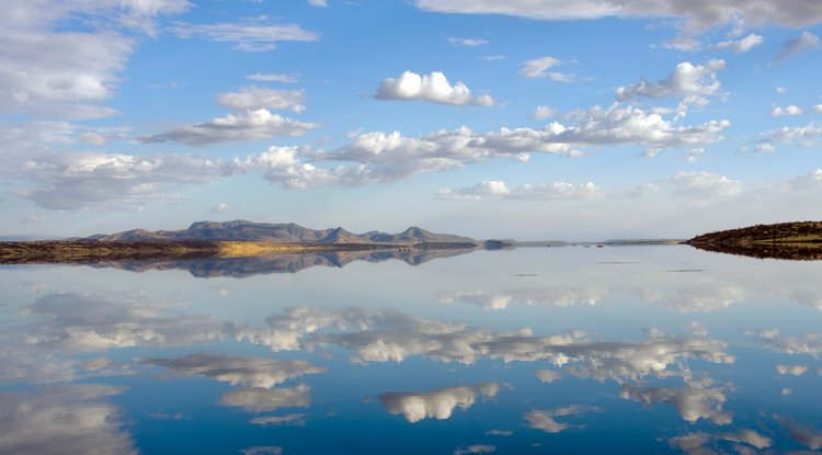 Lake Magadi, pictured during the wet season, periodically dries and floods in response to seasonal rains that cover the lakebed evaporites with up to 3 to 6 feet of water. (Photo: Richard Owen)