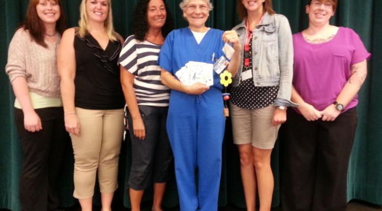 UA nurse practitioner Lisette LeCorgne (in blue scrubs) earned a Ben's Bell Award in August.