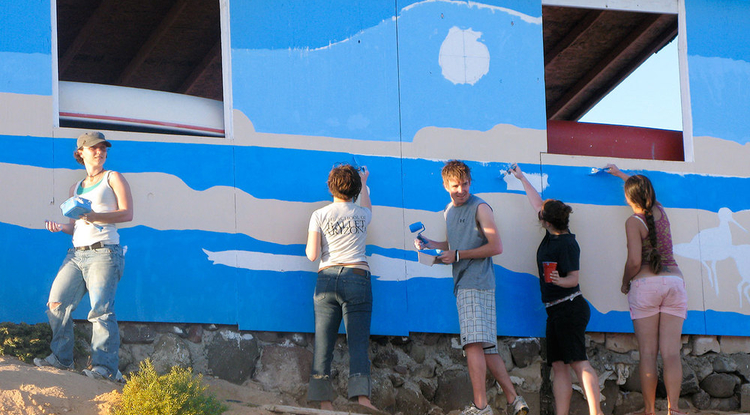 "Students in Ellen McMahon's ""Critical Issues in Design"" course work on a mural of endangered animals in a coastal community in Mexico. McMahon tries to increase her students' environmental awareness by engaging them in cross-disciplinary projects at the UA and in the field."