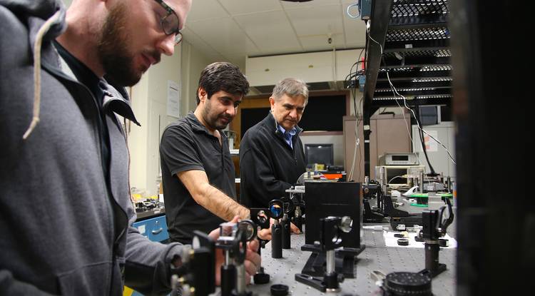From left: Doctoral student Joshua Olsen, postdoctoral researcher Veyesi Demir, and professor and inventor Nasser Peyghambarian. (Photo: Paul Tumarkin/Tech Launch Arizona)