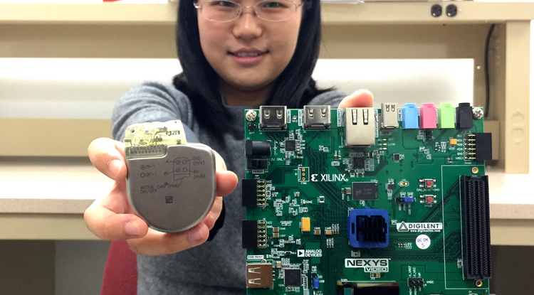 UA doctoral student Sixing Lu is helping associate professor Roman Lysecky develop technology on a prototype network-connected pacemaker (left) to detect hacking of a real pacemaker (right).
