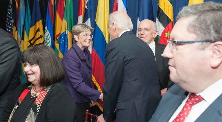 Mary Poulton shakes hands with Vice President Joe Biden during a ceremony in Washington, D.C.