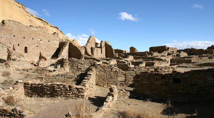 The north wall and room block of Pueblo Bonito, the largest of the great houses in Chaco Canyon. Pueblo Bonito is considered widely as the center of the Chaco world. (Photo: Thomas Swetnam)