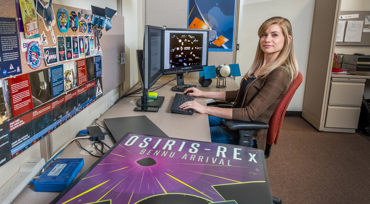 As graphic designer for the OSIRIS-REx mission, Heather Roper tells the spacecraft's story through images and illustrations that stay true to the science. (Photo: Bob Demers/UA News)