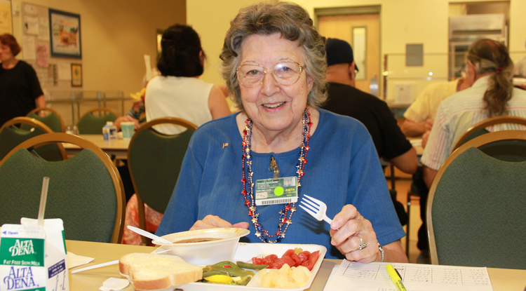A retired caregiver enjoys a meal while attending a SNAP-Ed class on heart-healthy nutrition at the Glendale Adult Center. (Photo courtesy of UA Cooperative Extension)