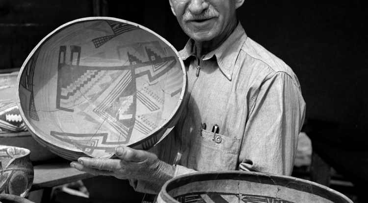 Byron Cummings, with a large decorated pottery vessel. (Photo by Tad Nichols)