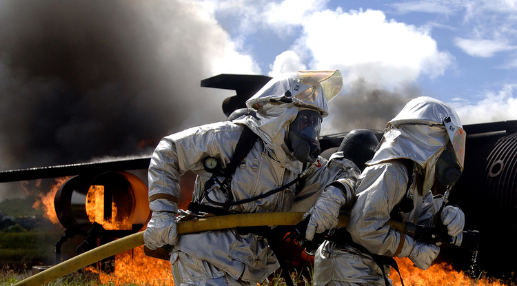 Air Force firefighters work to put out a fire as part of a simulated aircraft crash during an exercise at Andersen Air Force Base in Guam. The routine exercise is conducted at the base a few times a year to sharpen the mobility and wartime capabilities of participating service members. (U.S. Air Force Photo by Staff Sgt. Bennie J. Davis III)