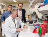 Frederic Zenhausern, PhD (seated), works with colleagues Kenneth Knox, MD, and Ting Wang, PhD (left), on research that combines their knowledge in engineering and medicine to find a new model to study pulmonary diseases.