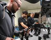 From left: Ph.D student Joshua Olsen, postdoc Veyesi Demir, and professor/inventor Nasser Peyghambarian. Photo credit: Paul Tumarkin/Tech Launch Arizona