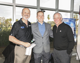 From left: TLA Vice President Doug Hockstad, Student Innovator of the Year Dawson Baker, and UA President Robert C. Robbins. Photo credit: Tech Launch Arizona