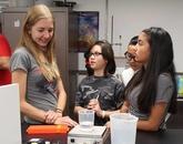 BlastOff! participants investigate why salt dissolves in water.