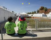 Volunteers take a break amid the dozens of festival tents.